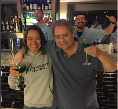 Dennis and me with green martini and green wine