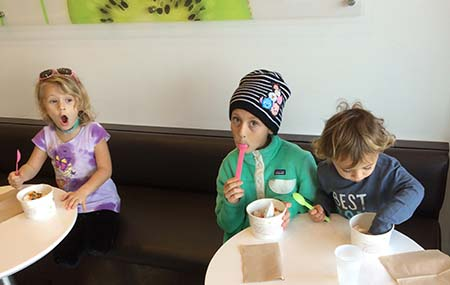 Kids enjoying yougurt