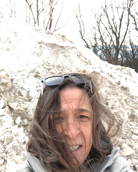 me in front of a pile of snow